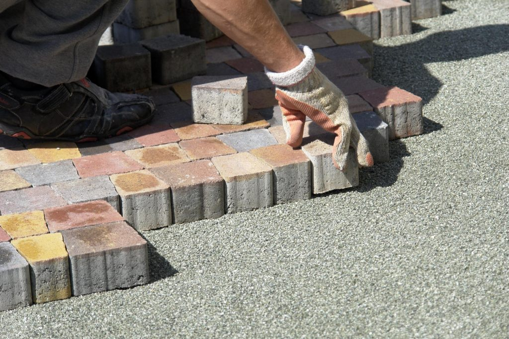 concrete and masonry worker doing driveway installation
