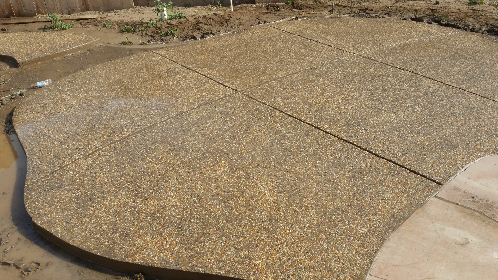 this picture shows concrd stamped concrete driveway